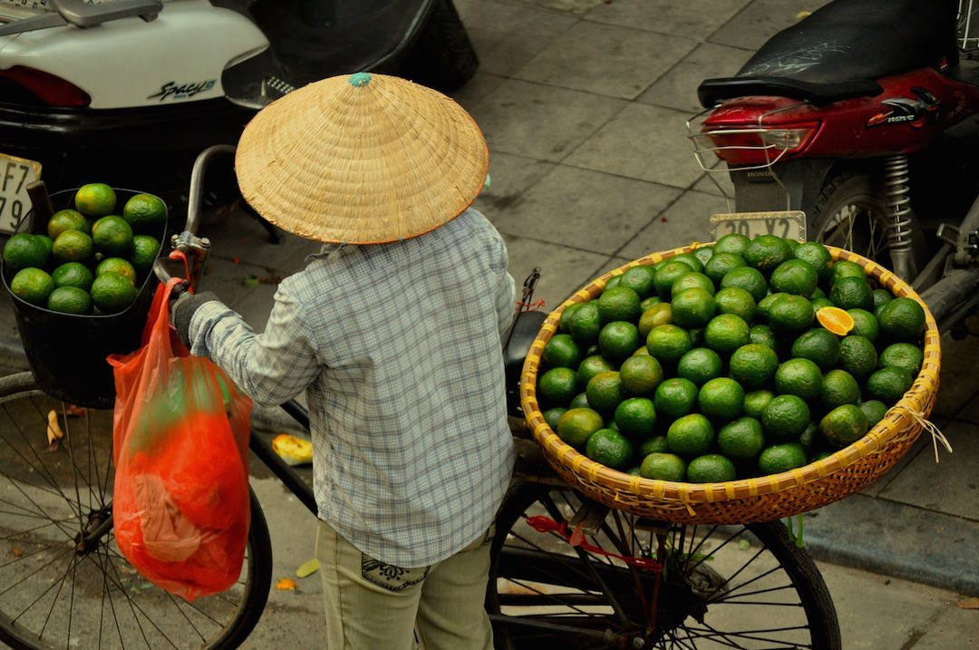 bucket list travel destinations, market woman, Hanoi, Vietnam